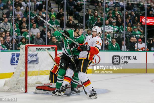 Dallas Stars center Mattias Janmark and Calgary Flames defenseman Travis Hamonic battle for position in front of goaltender Jon Gillies during the...