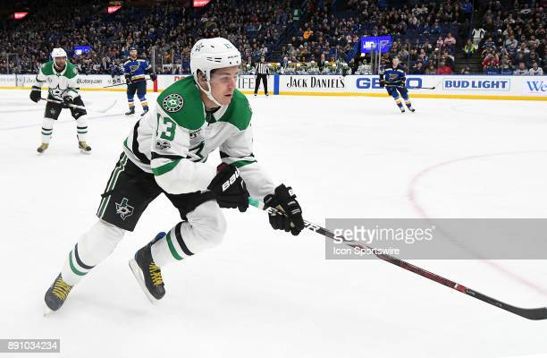 Dallas Stars center Mattias Janmark goes after a loose puck on the boards during a NHL game between the Dallas Stars and the St Louis Blues on...