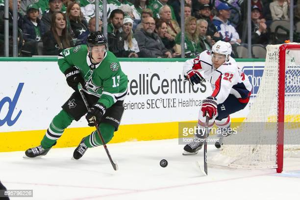 Dallas Stars center Mattias Janmark plays the puck with Washington Capitals defenseman Madison Bowey defending during the hockey game between the...