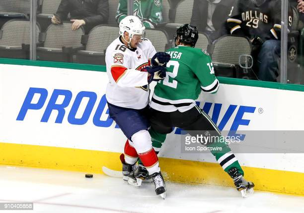 Dallas Stars center Radek Faksa and Florida center Aleksander Barkov fight for a loose puck during the game between the Dallas Stars and the Florida...