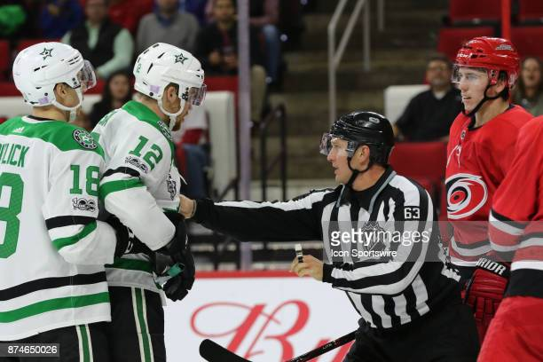 Dallas Stars Center Radek Faksa getting pushed out of a fight by back judge Jim Quirk during the 3rd period of the Carolina Hurricanes versus the...