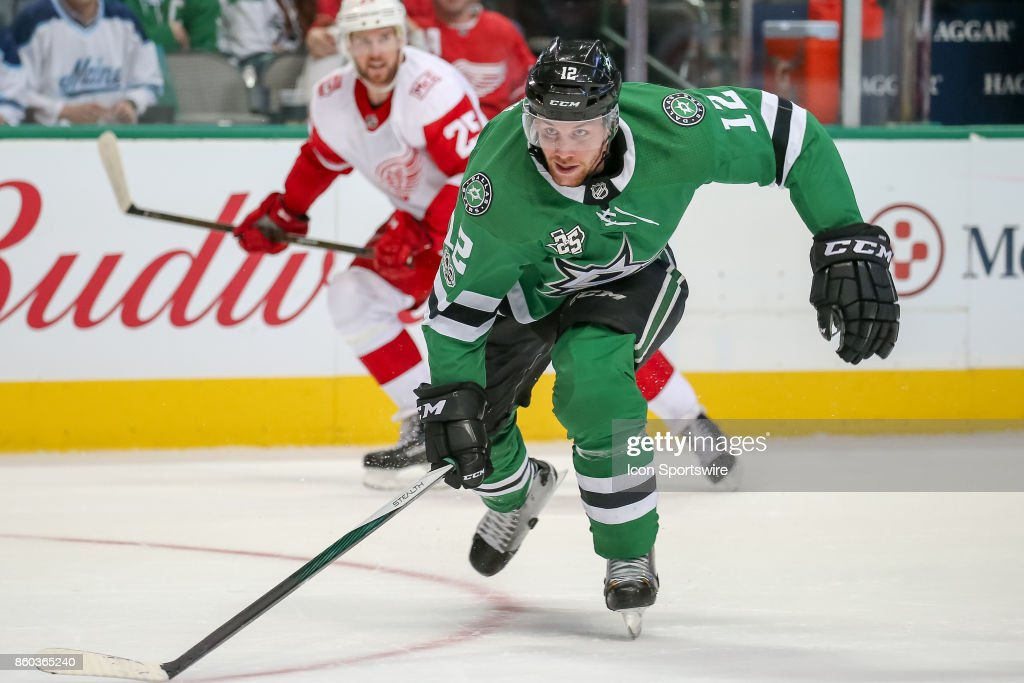 Dallas Stars Center Radek Faksa (12) skates into the attacking zone during the NHL game between the Detroit Red Wings and Dallas Stars on October 10, 2017 at the American Airlines Center in Dallas, TX.