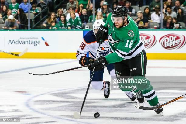 Dallas Stars center Radek Faksa skates up the ice as Edmonton Oilers center Ryan Strome chases him during the game between the Dallas Stars and the...