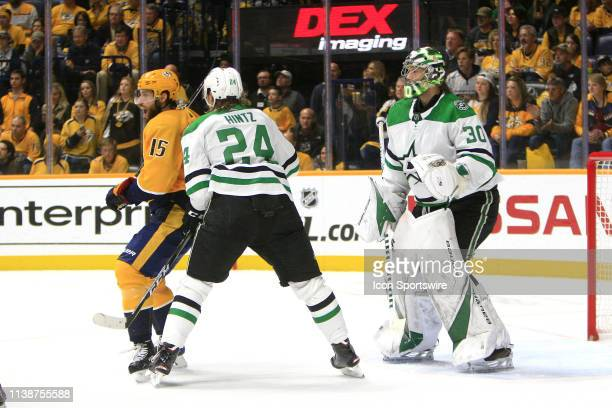 Dallas Stars center Roope Hintz defends against Nashville Predators right wing Craig Smith in front of Dallas Stars goalie Ben Bishop during Game...