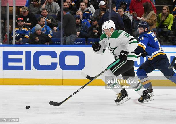 Dallas Stars center Tyler Pitlick and St Louis Blues left wing Vladimir Sobotka compete for the puck in the first period during a NHL game between...