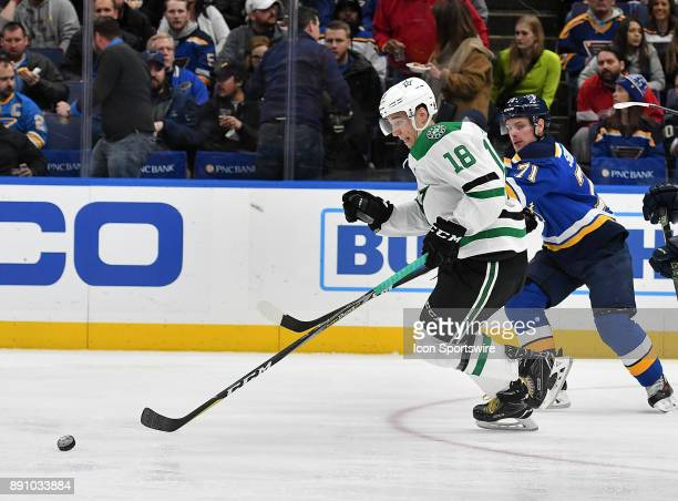 Dallas Stars center Tyler Pitlick skates with the puck ahead of St Louis Blues left wing Vladimir Sobotka in the first period during a NHL game...