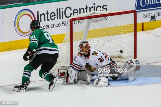 Dallas Stars center Tyler Seguin shoots the puck and scores a goal in the shootout over Chicago Blackhawks goalie Anton Forsberg during the game...