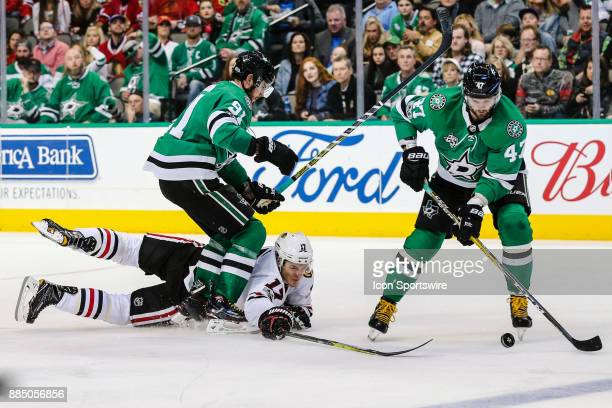 Dallas Stars center Tyler Seguin skates over a diving Chicago Blackhawks left wing Lance Bouma as he tries to poke the puck away from Dallas Stars...