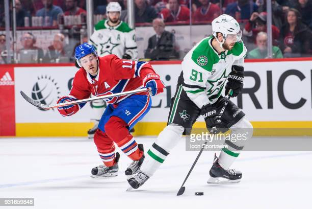 Dallas Stars center Tyler Seguin skates with the puck while being chased by Montreal Canadiens right wing Brendan Gallagher during the third period...