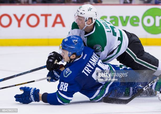 Dallas Stars Defenceman Esa Lindell checks Vancouver Canucks Defenceman Nikita Tryamkin during a NHL hockey game on March 16 at Rogers Arena in...