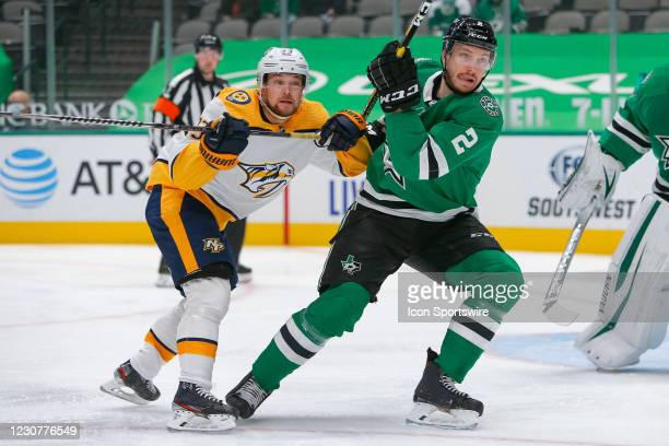 Dallas Stars Defenceman Jamie Oleksiak fights through a check by Nashville Predators Right Wing Viktor Arvidsson during the game between the...