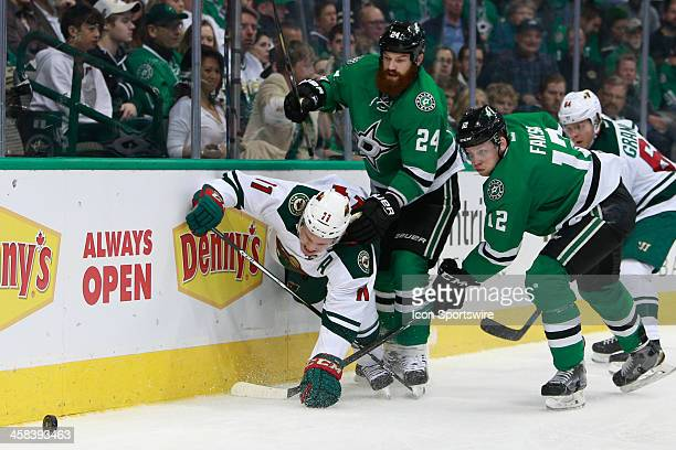 Dallas Stars Defenceman Jordie Benn takes down Minnesota Wild Left Wing Zach Parise during the NHL game between the Minnesota Wild and Dallas Stars...