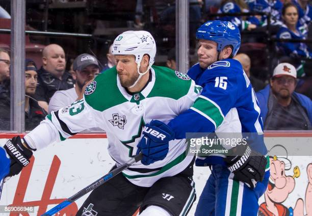 Dallas Stars Defenceman Marc Methot battles with Vancouver Canucks Right Wing Derek Dorsett in a NHL hockey game on October 30 at Rogers Arena in...