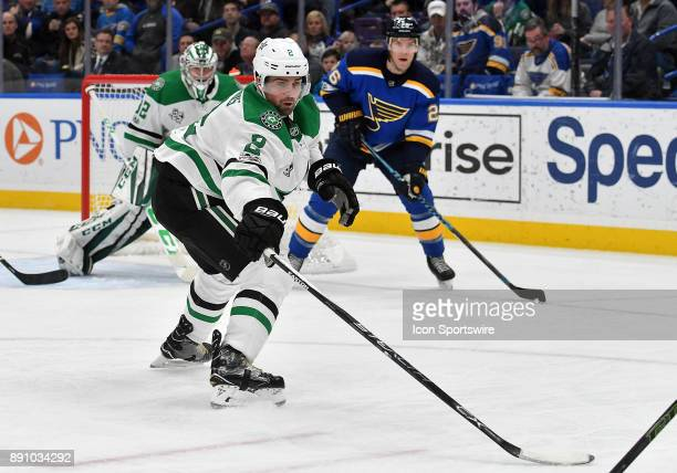 Dallas Stars defenseman Dan Hamhuis reaches to get the puck on the boards during a NHL game between the Dallas Stars and the St Louis Blues on...