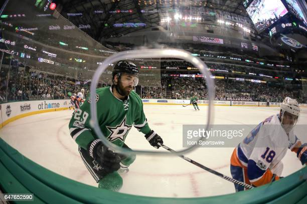 Dallas Stars defenseman Greg Pateryn and New York Islanders right wing Ryan Strome chase the puck along the boards during the game between the Dallas...