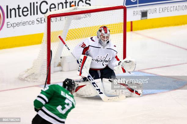 Dallas Stars defenseman John Klingberg fires a shot on Washington Capitals goalie Braden Holtby during the hockey game between the Washington...