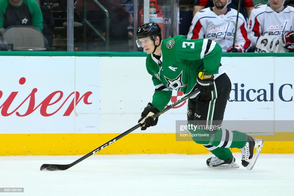 Dallas Stars defenseman John Klingberg (3) handles the puck on the power play during the hockey game between the Washington Capitals and Dallas Stars on December 19, 2017 at American Airlines Center in Dallas, TX.