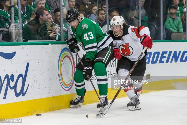 Dallas Stars defenseman Roman Polak and New Jersey Devils left wing Brett Seney chase the puck along the boards during the game between the Dallas...
