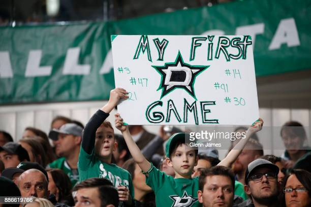 Dallas Stars fans cheer on their team against the Nashville Predators at the American Airlines Center on December 5 2017 in Dallas Texas