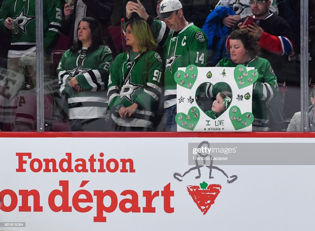 Dallas Stars' fans watch the warmup prior to the NHL game against the Montreal Canadiens at the Bell Centre on March 13, 2018 in Montreal, Quebec, Canada.