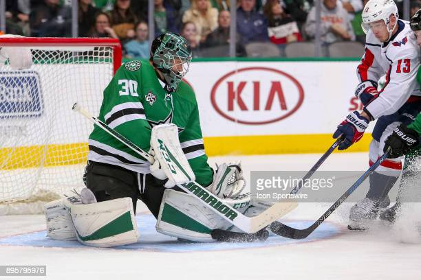 Dallas Stars goalie Ben Bishop plays a loose puck during the hockey game between the Washington Capitals and Dallas Stars on December 19 2017 at...