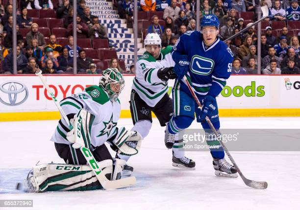 Dallas Stars Goalie Kari Lehtonen makes a save as Vancouver Canucks Center Bo Horvat and Dallas Stars Defenceman Dan Hamhuis look on during their NHL...