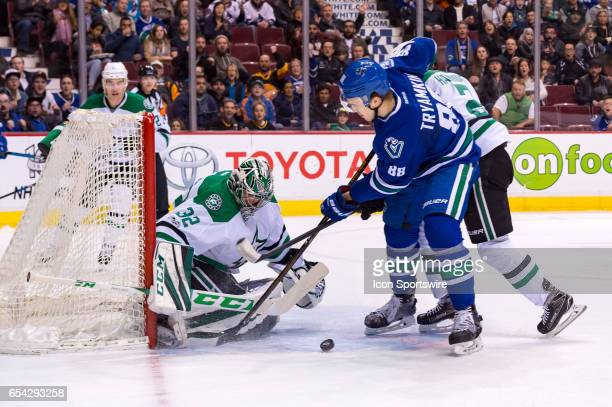 Dallas Stars Goalie Kari Lehtonen makes a save on Vancouver Canucks Defenceman Nikita Tryamkin during their NHL game at Rogers Arena on March 16 2017...