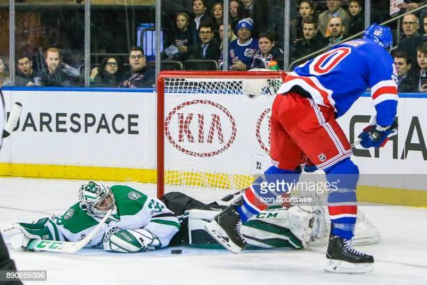 Dallas Stars Goalie Kari Lehtonen makes save on break away shot from New York Rangers Center JT Miller during the Dallas Stars and New York Rangers...