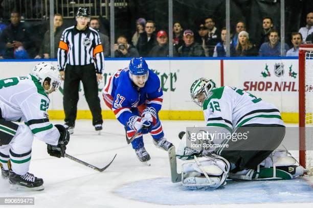 Dallas Stars Goalie Kari Lehtonen makes save on shot by New York Rangers Right Wing Jesper Fast during the Dallas Stars and New York Rangers NHL game...