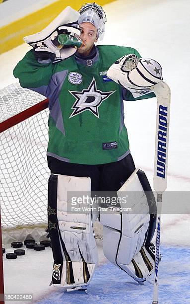 Dallas Stars goalie Richard Bachman takes a water break during the team's practice session at the Fort Worth Convention Center in Fort Worth Texas on...