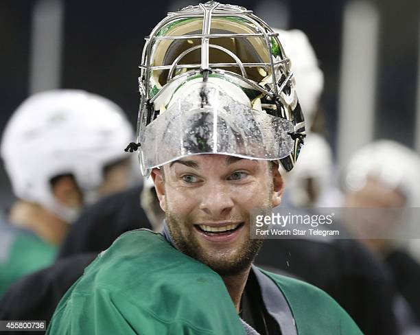 Dallas Stars goaltender Jack Campbell laughs with teammates during a break at training camp in Fort Worth, Texas, on Saturday, Sept. 20, 2014.