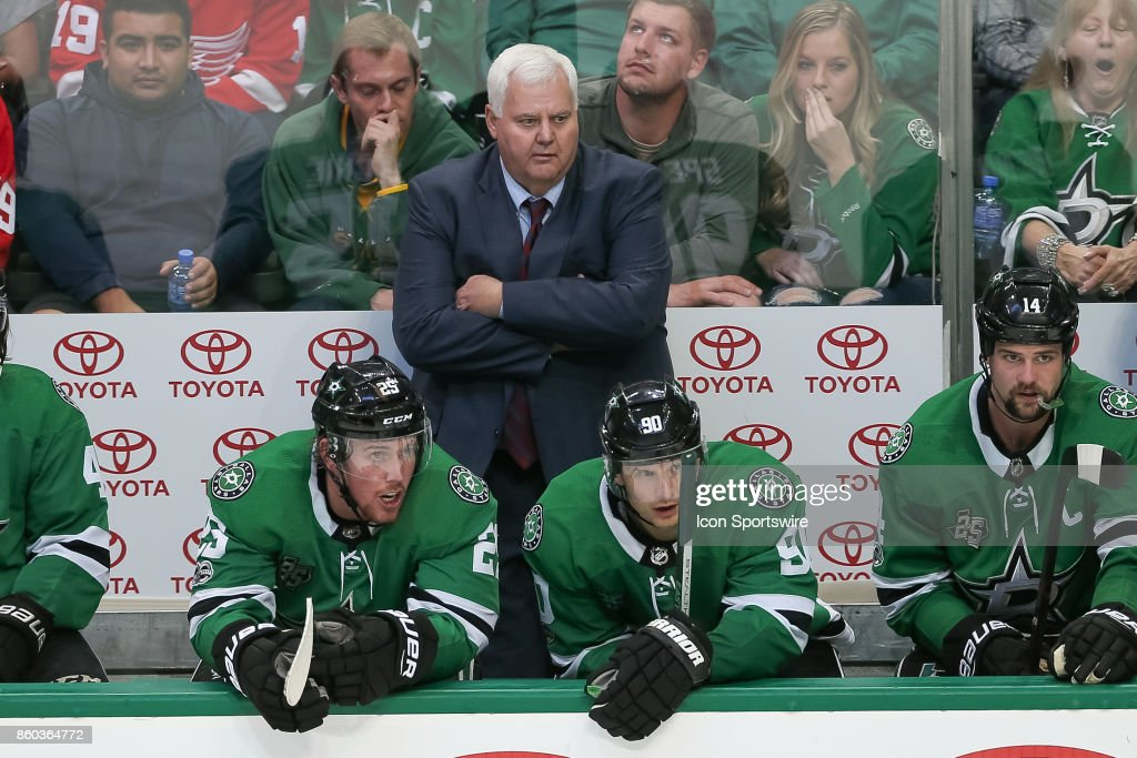 Dallas Stars Head Coach Ken Hitchcock looks on from the bench during the NHL game between the Detroit Red Wings and Dallas Stars on October 10, 2017 at the American Airlines Center in Dallas, TX.