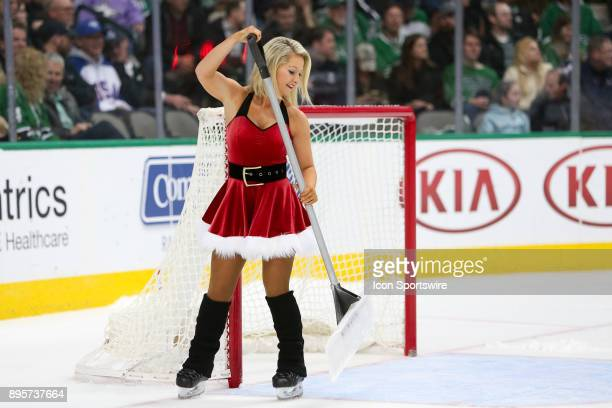 Dallas Stars Ice Girl cleans the ice during the hockey game between the Washington Capitals and Dallas Stars on December 19 2017 at American Airlines...