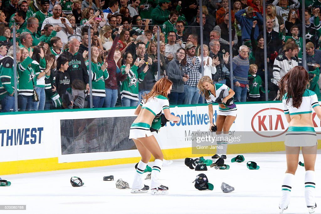 Dallas Stars Ice Girls pick up hats after Jason Spezza #90 of the Dallas Stars score the game winning goal against the Nashville Predators at the American Airlines Center on April 9, 2016 in Dallas, Texas.