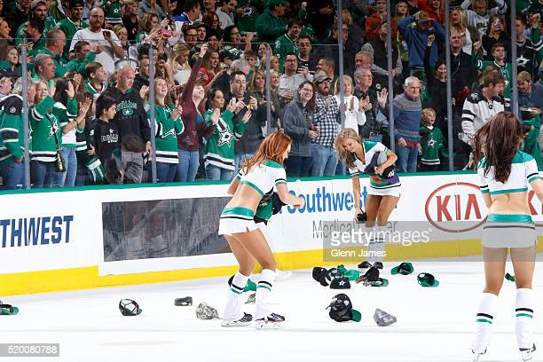 Dallas Stars Ice Girls pick up hats after Jason Spezza of the Dallas Stars score the game winning goal against the Nashville Predators at the...