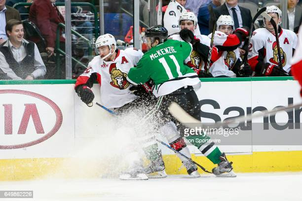 Dallas Stars Left Wing Curtis McKenzie hits Ottawa Senators Center Chris Kelly during the NHL hockey game between the Ottawa Senators and Dallas...