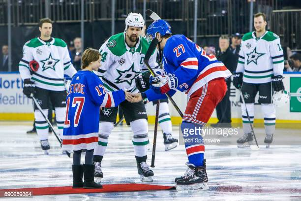 Dallas Stars Left Wing Jamie Benn and New York Rangers Defenseman Ryan McDonagh greet child from MSG Garden of Dreams prior to the Dallas Stars and...