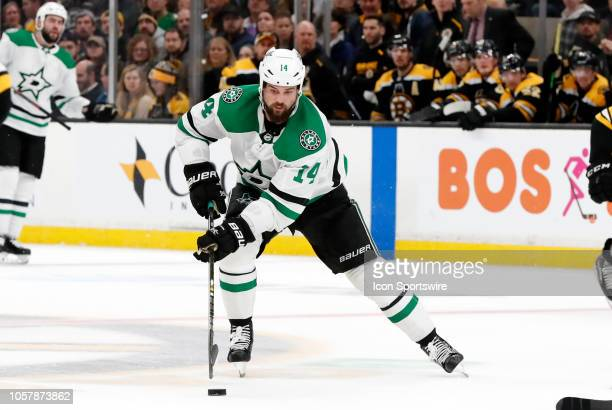 Dallas Stars left wing Jamie Benn carries the puck through the neutral zone during a game between the Boston Bruins and the Dallas Stars on November...