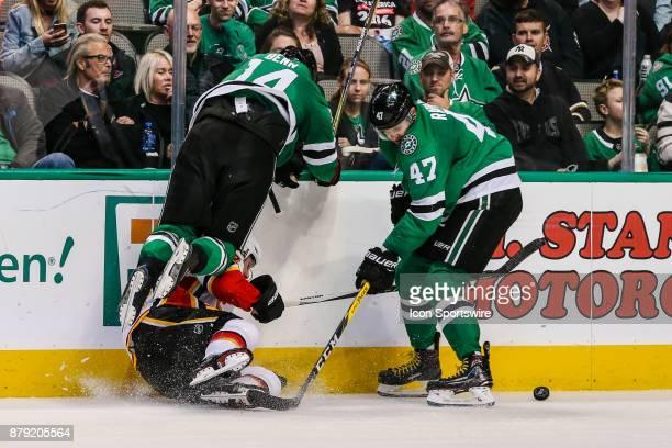 Dallas Stars left wing Jamie Benn falls over Calgary Flames center Sam Bennett trying to pass the puck to Dallas Stars right wing Alexander Radulov...