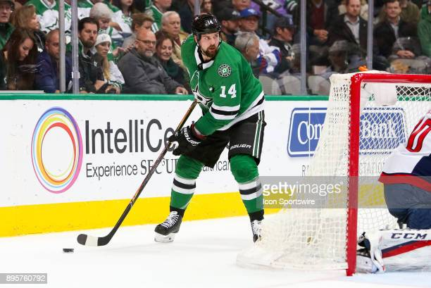 Dallas Stars left wing Jamie Benn handles the puck behind the Washington Capitals net during the hockey game between the Washington Capitals and...