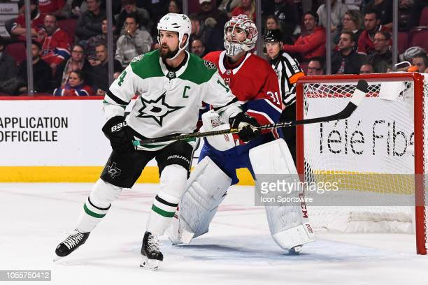 Dallas Stars left wing Jamie Benn tracks the play while standing in front of Montreal Canadiens goalie Carey Price during the Dallas Stars versus the...