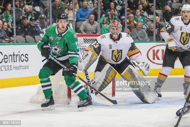 Dallas Stars Left Wing Mattias Janmark watches the puck with Vegas Golden Knights Goalie Maxime Lagace during the game between the Dallas Stars and...
