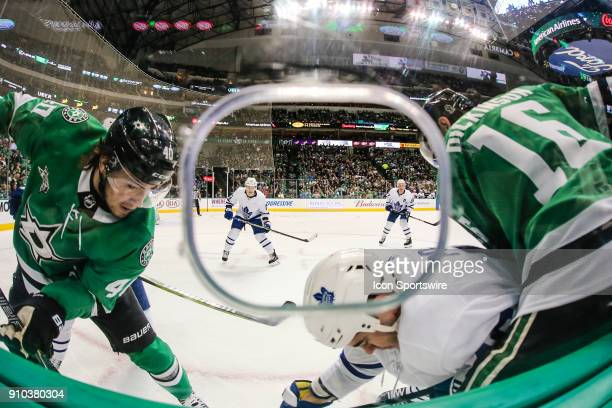Dallas Stars left wing Remi Elie center Jason Dickinson and Toronto Maple Leafs defenseman Roman Polak battle for the puck along the boards during...