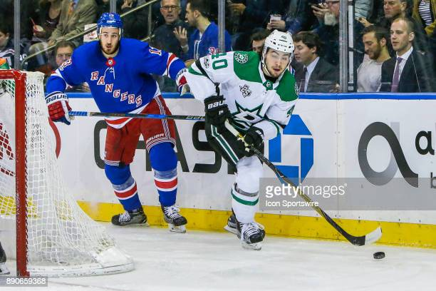 Dallas Stars Left Wing Remi Elie skates with puck as New York Rangers Center Kevin Hayes trails play during the Dallas Stars and New York Rangers NHL...