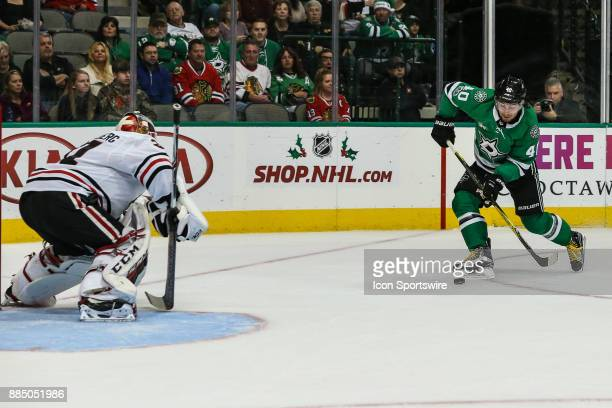 Dallas Stars left wing Remi Elie takes a shot against Chicago Blackhawks goalie Anton Forsberg during the game between the Dallas Stars and the...