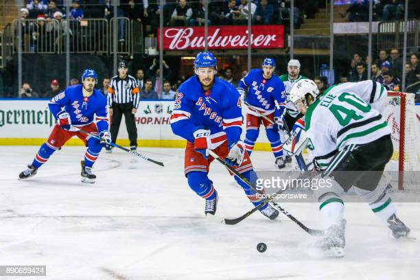 Dallas Stars Left Wing Remi Elie tracks loose puck as New York Rangers Defenseman Brendan Smith closes in to defend during the Dallas Stars and New...