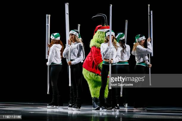 Dallas Stars mascot Victor E Green performs with the Dallas Stars Ice Girls before the game between the Dallas Stars and the Calgary Flames on...