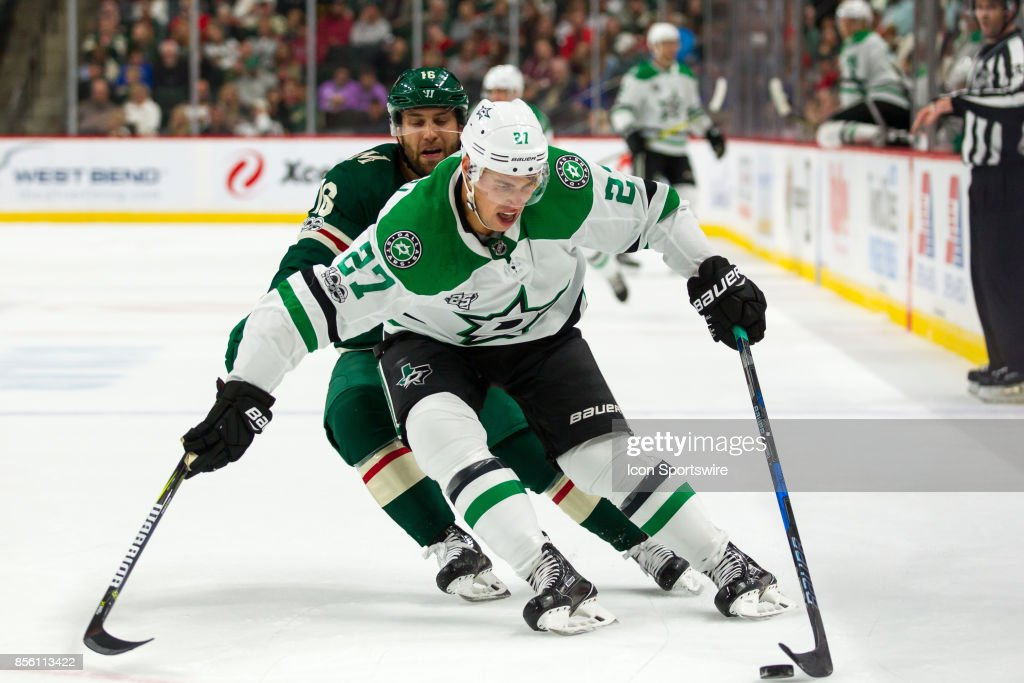 Dallas Stars right wing Adam Cracknell (27) protects the puck from Minnesota Wild left wing Jason Zucker (16) during the preseason game between the Dallas Stars and the Minnesota Wild on September 30, 2017 at Xcel Energy Center in St. Paul, Minnesota.