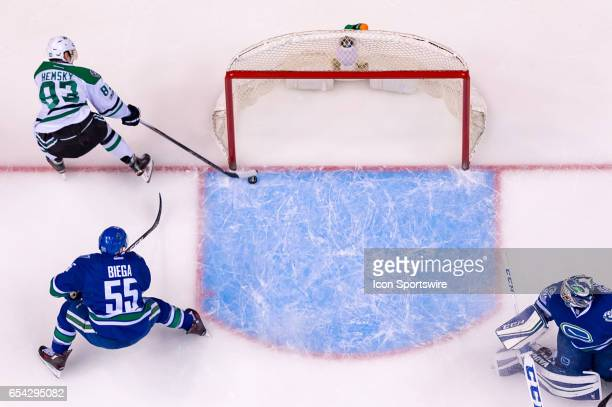 Dallas Stars Right Wing Ales Hemsky scores a goal on Vancouver Canucks Goalie Ryan Miller as Vancouver Canucks Defenceman Alex Biega defends during...
