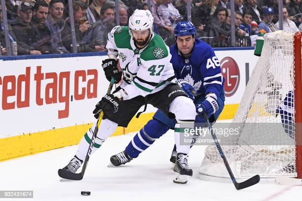 Dallas Stars Right Wing Alexander Radulov is chased by Toronto Maple Leafs Defenceman Roman Polak during the regular season NHL game between the...